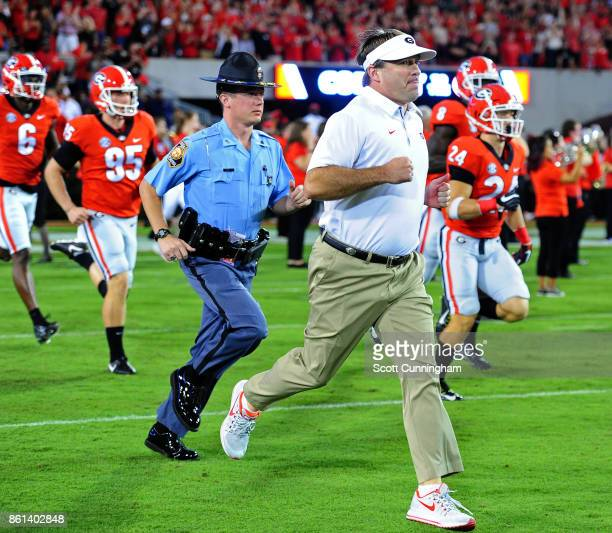 Head Coach Kirby Smart of the Georgia Bulldogs leads his team onto the field before the game against the Missouri Tigers at Sanford Stadium on...