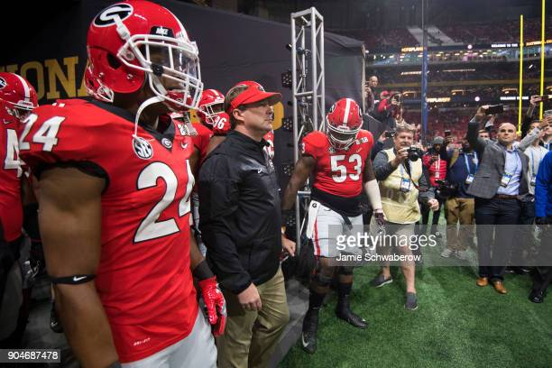 Head Coach Kirby Smart of the Georgia Bulldogs leads his team onto the field against the Alabama Crimson Tide during the College Football Playoff...