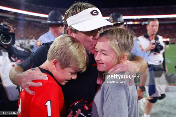 Head coach Kirby Smart of the Georgia Bulldogs reacts with his children after a 23-17 win over the Notre Dame Fighting Irish at Sanford Stadium on...