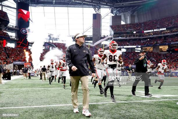 head coach Kirby Smart of the Georgia Bulldogs runs out of the tunnel with his team prior to the game against the Auburn Tigers in the SEC...