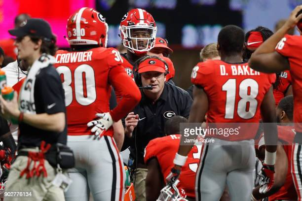 Head coach Kirby Smart of the Georgia Bulldogs talks to his players during a time out during the second half against the Alabama Crimson Tide in the...