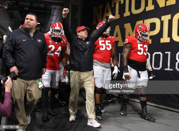 Head coach Kirby Smart of the Georgia Bulldogs walks out of the tunnel with his players during warm ups prior to the game against the Alabama Crimson...