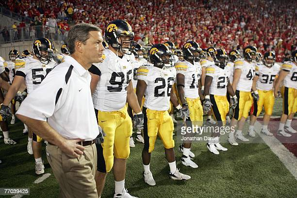 Head coach Kirk Ferentz of the Iowa Hawkeyes gets ready to lead his team onto the field before the game against the Wisconsin Badgers at Camp Randall...