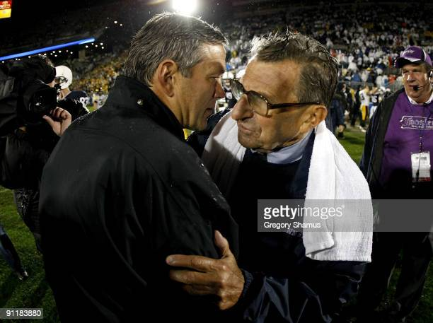 Head coach Kirk Ferentz of the Iowa Hawkeyes shakes hands with head coach Joe Paterno of the Penn State Nittnay Lions after defeating them 2110 on...