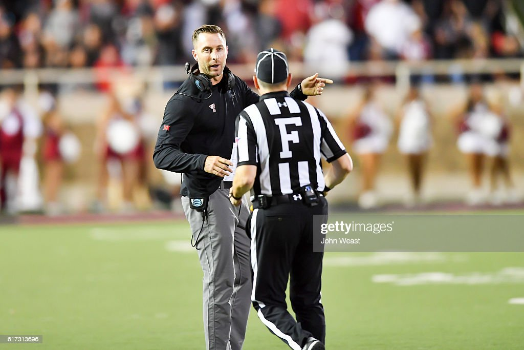 Head coach Kliff Kingsbury of the Texas Tech Red Raiders discusses an officials call during the game between the Texas Tech Red Raiders and the Oklahoma Sooners on October 22, 2016 at AT&T Jones Stadium in Lubbock, Texas. Oklahoma won the game 66-59.