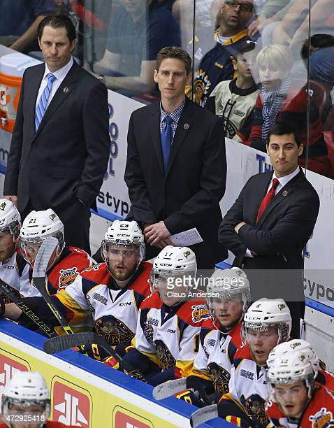 Head coach Kris Knoblauch and assistants Jay McKee and Vince Laise of the Erie Otters watch the action against the Oshawa Generals in Game One of the...