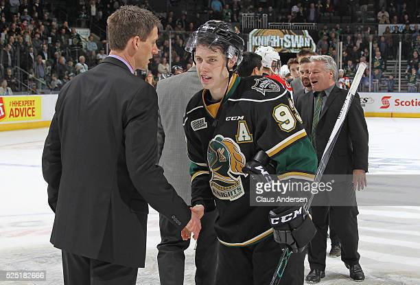 Head coach Kris Knoblauch of the Erie Otters congratulates Mitchell Marner of the London Knights after the Knights won the OHL Western Conference...