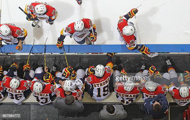 Head coach Kris Knoblauch of the Erie Otters gives instructions during a timeout against the London Knights in an OHL game at Budweiser Gardens on...