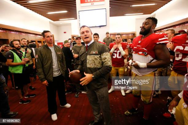 Head Coach Kyle Shanahan and General Manager John Lynch of the San Francisco 49ers get ready to award the first game ball in the locker room...