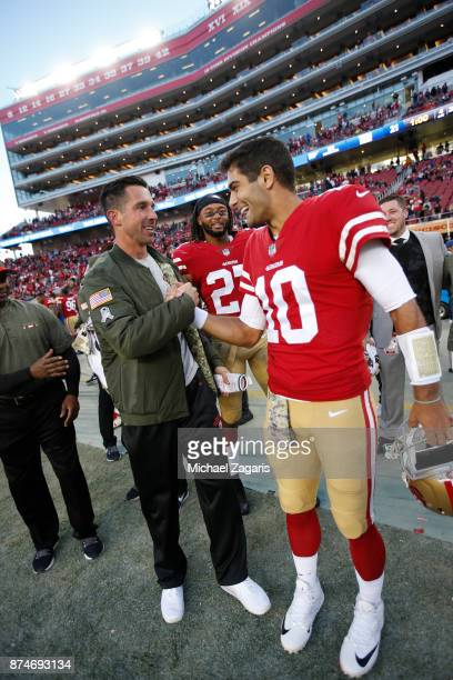 Head Coach Kyle Shanahan and Jimmy Garoppolo of the San Francisco 49ers celebrate on the sideline following the game against the New York Giants at...