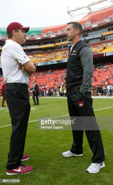 Head Coach Kyle Shanahan of the San Francisco 49ers and Head Coach Jay Gruden of the Washington Redskins talk on the field prior to the game at FedEx...