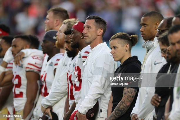 Head coach Kyle Shanahan of the San Francisco 49ers and offensive assistant coach Katie Sowers look on prior to Super Bowl LIV against the Kansas...