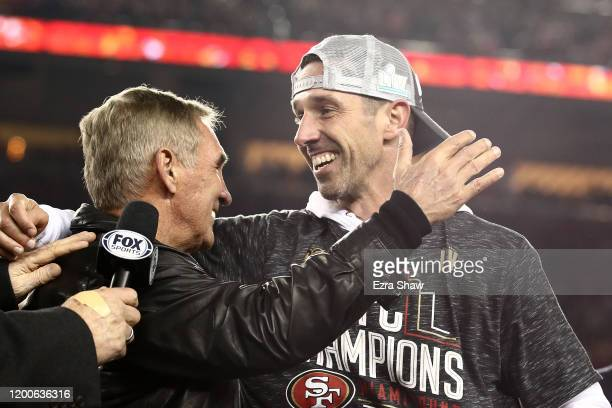 Head coach Kyle Shanahan of the San Francisco 49ers celebrates with his father Mike Shanahan after winning the NFC Championship game against the...