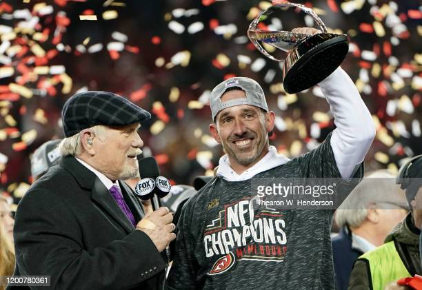 Head coach Kyle Shanahan of the San Francisco 49ers celebrates with the George Halas Trophy after winning the NFC Championship game against the Green...