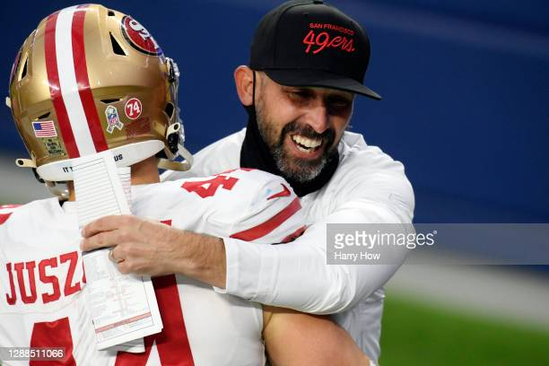 Head coach Kyle Shanahan of the San Francisco 49ers celebrates with Kyle Juszczyk after defeating the Los Angeles Rams 23-20 at SoFi Stadium on...