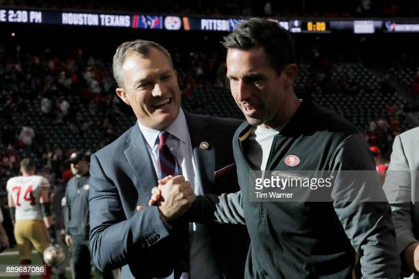 Head coach Kyle Shanahan of the San Francisco 49ers celebrates with general manager John Lynch after the game against the Houston Texans at NRG...