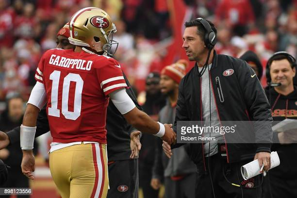 Head coach Kyle Shanahan of the San Francisco 49ers congratulates Jimmy Garoppolo after a oneyard touchdown run against the Jacksonville Jaguars...