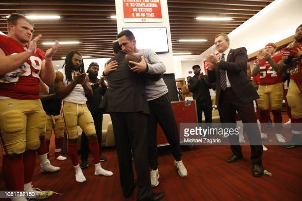 Head Coach Kyle Shanahan of the San Francisco 49ers gives the game ball to CEO Jed York during an emotional post game moment in the locker room...