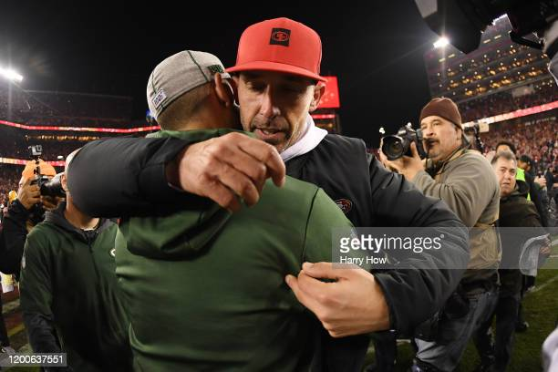 Head coach Kyle Shanahan of the San Francisco 49ers hugs head coach Matt LaFleur of the Green Bay Packers after winning the NFC Championship game...