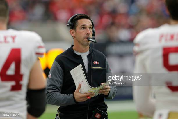 Head coach Kyle Shanahan of the San Francisco 49ers looks at the video board in the fourth quarter against the Houston Texans at NRG Stadium on...