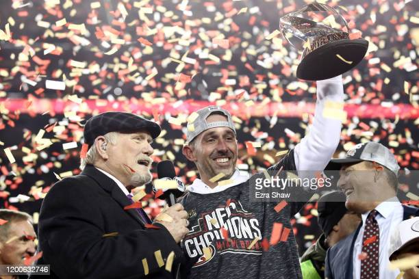 Head coach Kyle Shanahan of the San Francisco 49ers of the San Francisco 49ers celebrates with the George Halas Trophy after winning the NFC...