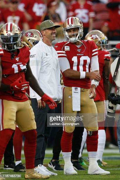 Head coach Kyle Shanahan of the San Francisco 49ers talks to quarterback Jimmy Garoppolo before the game against the Seattle Seahawks at Levi's...