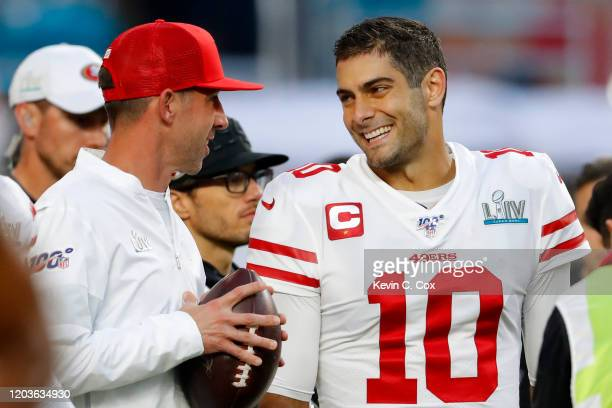 Head coach Kyle Shanahan of the San Francisco 49ers talks with Jimmy Garoppolo prior to Super Bowl LIV against the Kansas City Chiefs at Hard Rock...