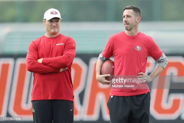 Head coach Kyle Shanahan of the San Francisco 49ers talks with general manager John Lynch during practice for Super Bowl LIV at the Greentree...