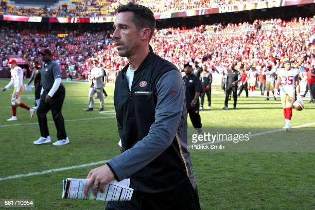 Head coach Kyle Shanahan of the San Francisco 49ers walks onto the field after the San Francisco 49ers lost 2624 to the Washington Redskins at...