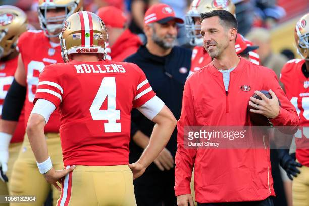 Head coach Kyle Shanahan speaks with Nick Mullens of the San Francisco 49ers prior to their game against the Oakland Raiders at Levi's Stadium on...