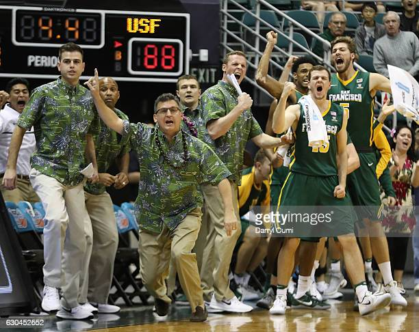Head coach Kyle Smith of the San Francisco Dons and the bench celebrate after Frankie Ferrari draws a charging foul to help secure the win in the...