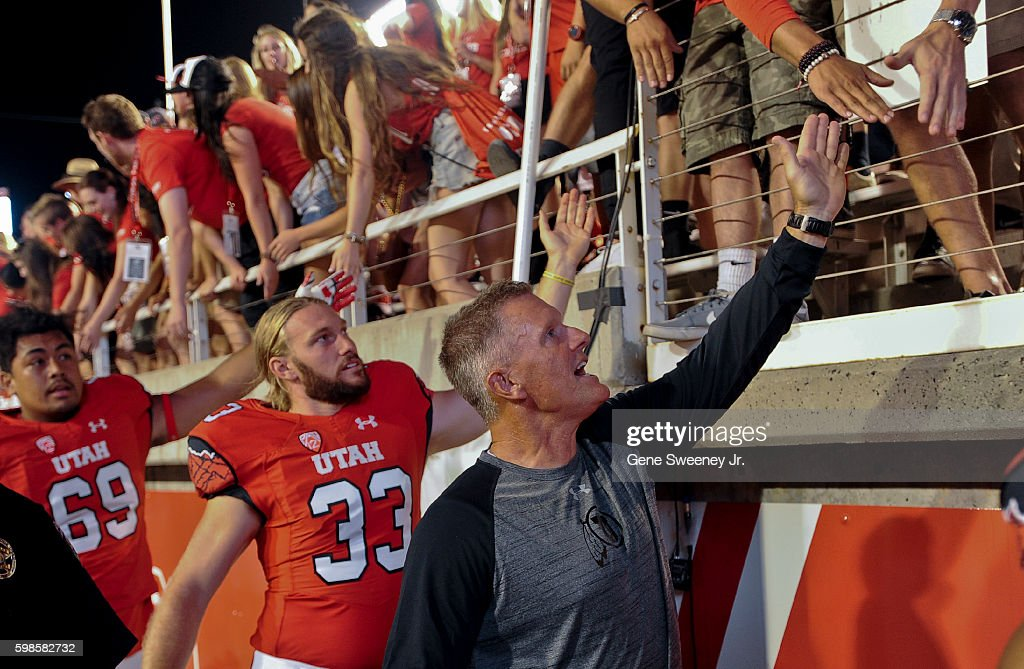 Head coach Kyle Whittingham leads players Mitch Wishnowsky #33 and Lo Falemaka #69 of the Utah Utes around the sidelines to shake fans' hands after their 24-0 win over the Southern Utah Thunderbirds at Rice-Eccles Stadium on September 1, 2016 in Salt Lake City, Utah.