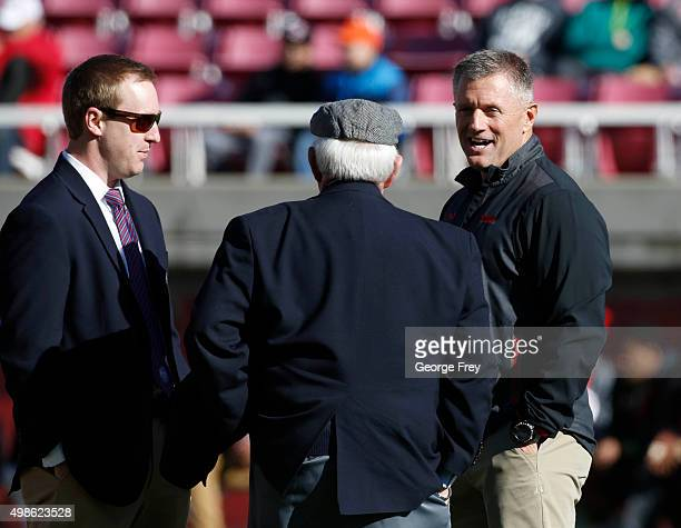 Head coach Kyle Whittingham of the Utah Utes talks with Peach Bowl officials before a game against the UCLA Bruins at a college football game at Rice...