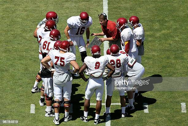 Head coach Lane Kiffin gives instructions in the offensive huddle during the USC Trojans spring game on May 1 2010 at the Los Angeles Memorial...