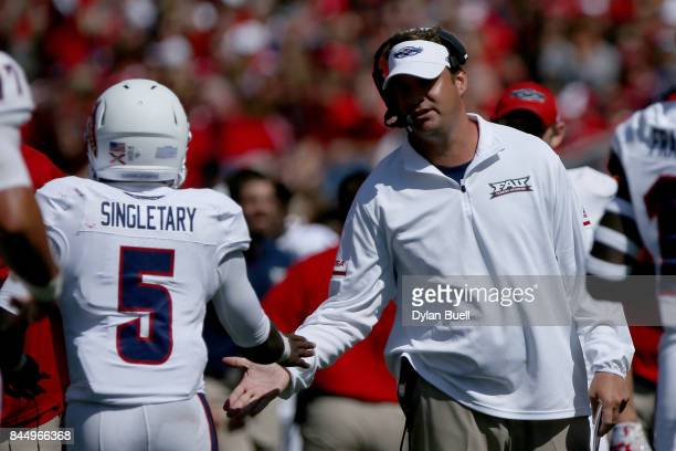 Head coach Lane Kiffin of the Florida Atlantic Owls congratulates Devin Singletary after scoring a touchdown in the second quarter against the...