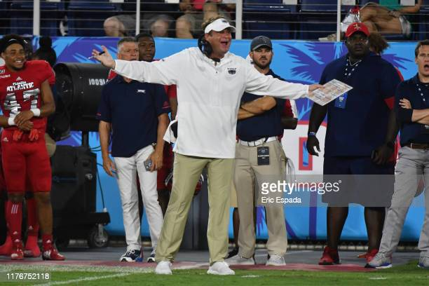 Head coach Lane Kiffin of the Florida Atlantic Owls disputes a call on the sidelines during the first half against the Marshall Thundering Herd at...