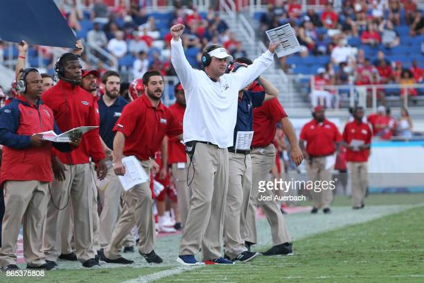Head coach Lane Kiffin of the Florida Atlantic Owls signals the players during second quarter action against the North Texas Mean Green on October 21...