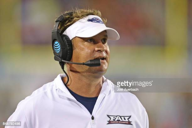 Head coach Lane Kiffin of the Florida Atlantic Owls talks on his headset during third quarter action against the Bethune Cookman Wildcats on...