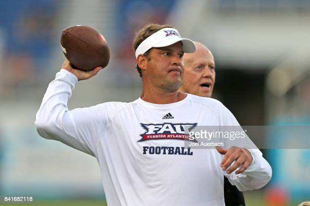 Head coach Lane Kiffin of the Florida Atlantic Owls throws the ball prior to the game against the Navy Midshipmen on September 1 2017 at FAU Stadium...