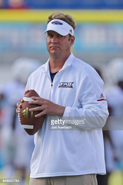 Head coach Lane Kiffin of the Florida Atlantic Owls watches the players warm up prior to the game against the Bethune Cookman Wildcats on September...
