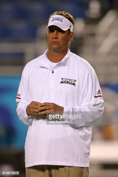 Head coach Lane Kiffin of the Florida Atlantic Owls watches the players warm up prior to the game against the Florida International Golden Panthers...