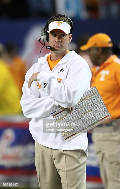 Head Coach Lane Kiffin of the Tennessee Volunteers watches the action during the ChickFilA Bowl game against the Virginia Tech Hokies at the Georgia...