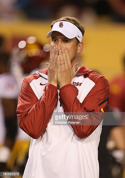 Head coach Lane Kiffin of the USC Trojans reacts during the college football game against the Arizona State Sun Devils at Sun Devil Stadium on...