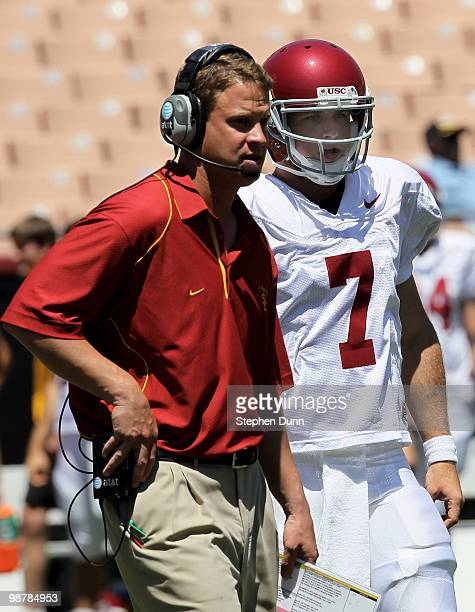 Head coach Lane Kiffin talks with quarterback Matt Barkley during the USC Trojans spring game on May 1 2010 at the Los Angeles Memorial Coliseum in...
