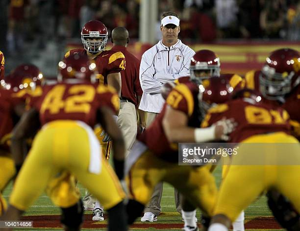 Head coach Lane Kiffin watches the USC Trojans warm up for their game with the Virginia Cavaliers at Los Angeles Memorial Coliseum on September 11...