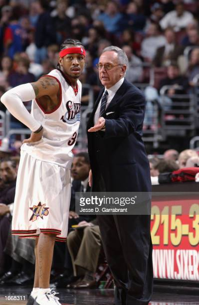 Head coach Larry Brown discusses play on the sideline with Allen Iverson of the Philadelphia 76ers during the NBA game against the San Antonio Spurs...