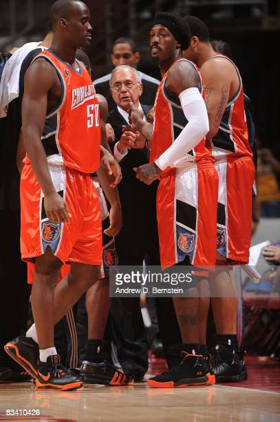 Head coach Larry Brown Gerald Wallace and Emeka Okafor of the Charlotte Bobcats talk on the sidelines during the game against the Los Angeles Lakers...