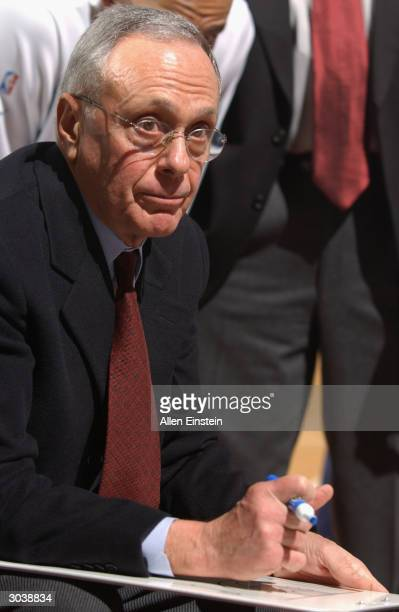Head coach Larry Brown of the Detroit Pistons draws up a play during the game against the Sacramento Kings on February 11 2004 at the Palace of...