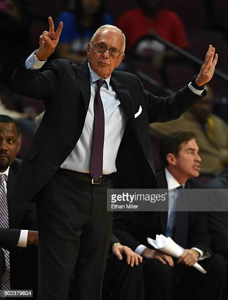 Head coach Larry Brown of the Southern Methodist Mustangs gestures to his players as they take on the Colorado Buffaloes during the championship game...