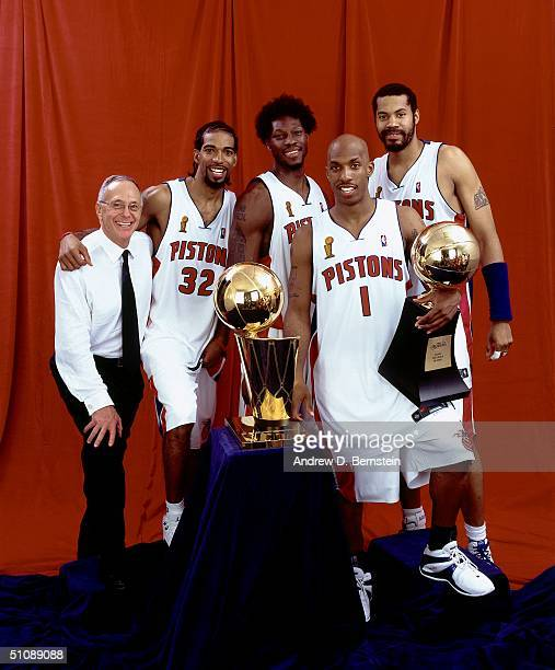 Head Coach Larry Brown, Richard Hamilton, Ben Wallace, Chauncey Billups and Rasheed Wallace of the Detroit Pistons pose with the championship trophy...
